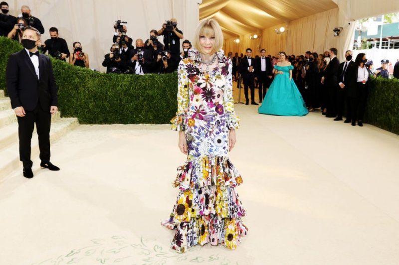 Vogue chief Dame Anna Wintour in a floral Oscar de la Renta dress