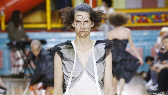 A male model in a sheer tunic