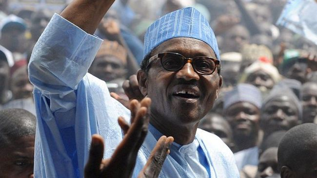 Leading opposition presidential candidate in forthcoming April polls and flag bearer of Congress for Progressive Change, retired General Muhammadu Buhari raises his hand to salute the crowd shortly on arrival to flag off his presidential campaign rally in Kaduna Wednesday, on March 2, 2011