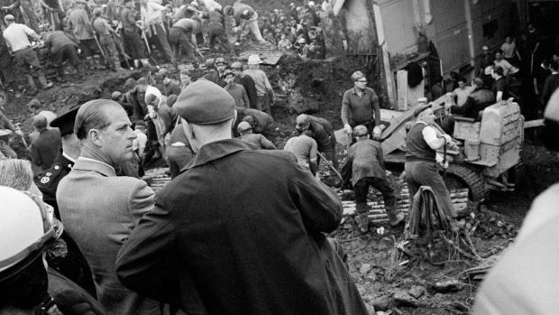 The duke met rescue workers and miners in Aberfan as people searched through the rubble