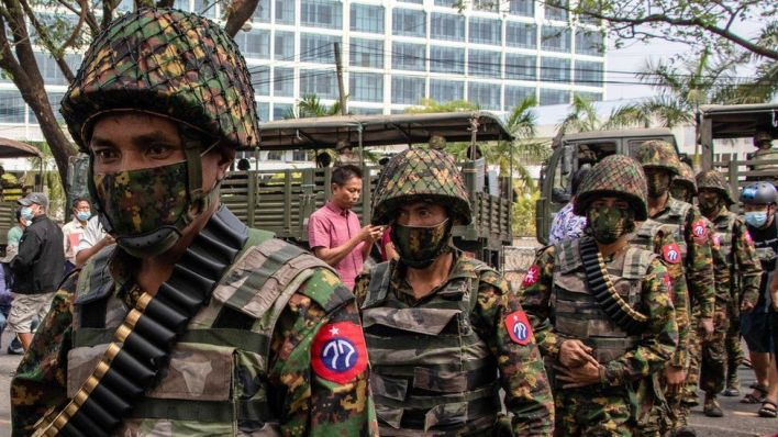Soldiers are seen patrolling the streets in Thingangyun