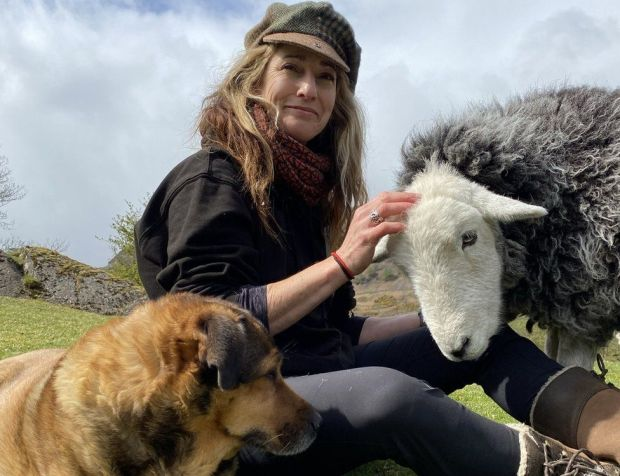 Jo Watson with a sheep and dog