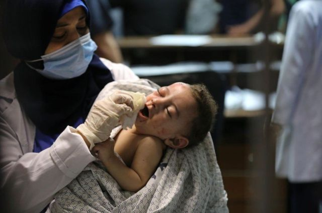 A baby injured in Israeli attack carried out to home of Palestinian Abu Khatab Family living in Al-Shati Camp in Gaza Strip, being brought to Shifa Hospital on May 15, 2021, in Gaza City, Gaza