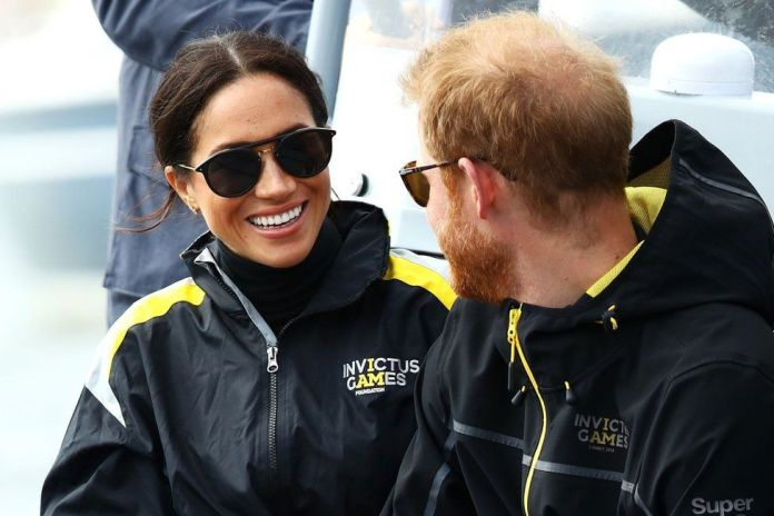 Meghan, Duchess of Sussex and Prince Harry, Duke of Sussex watch on during the Elliott 7 Team racing during the Sailing on day two of the Invictus Games Sydney 2018 on Sydney Harbour on October 21, 2018 in Sydney, Australia