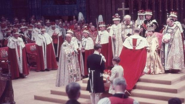 The Duke of Edinburgh pays homage to his wife, the newly crowned Queen Elizabeth II, during her coronation ceremony, 1953