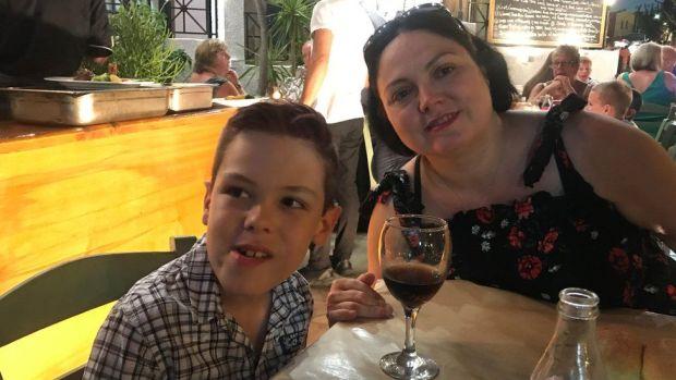 Paula Hansen and her son in Greece