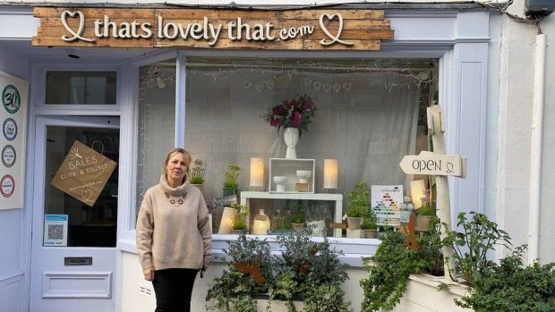 Lucy Hywel outside her shop