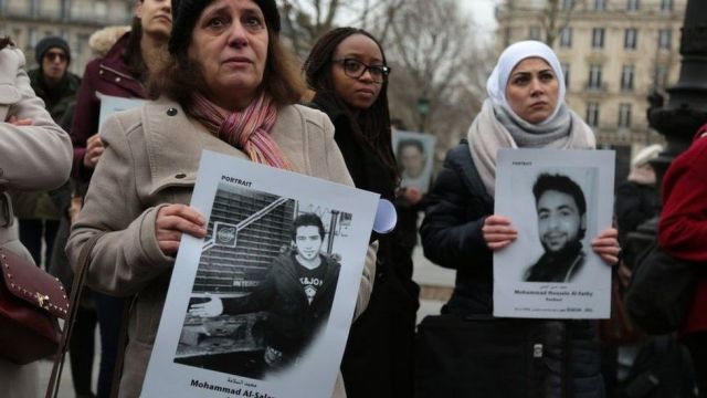 "Activists hold portraits of detained or missing Syrians at a demonstration in Paris, France, organised by ""Families for Freedom"" (27 January 2018)"