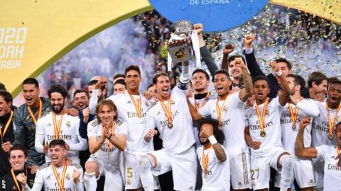 Real Madrid players celebrate beating Atletico Madrid in the Spanish Super Cup final