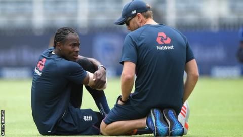 England fast bowler Jofra Archer talks to a physio about his elbow injury during a training session