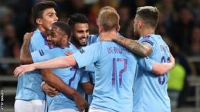 Manchester City celebrate a goal at Shakhtar Donetsk