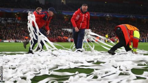 Stewards clean up toilet paper