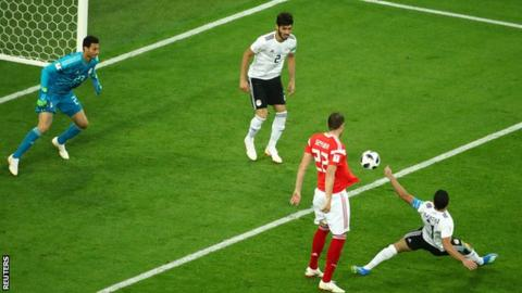 Egypt's Ahmed Fathi scores an own goal against Russia