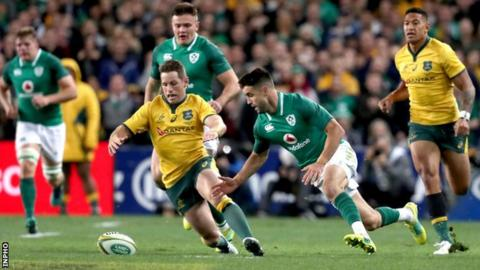 Australia's Bernard Foley with Conor Murray of Ireland scramble for the ball during the third Test in Sydney