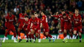 Liverpool players react
