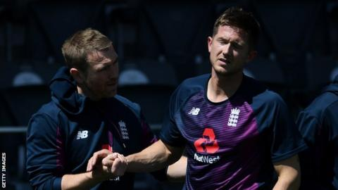 Joe Denly winces in pain after sustaining his injury