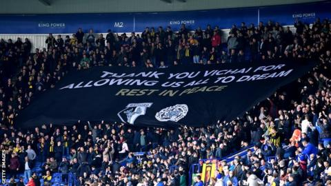 Watford fans hold aloft their banner at Leicester