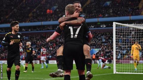 Manchester City's players celebrate scoring at Aston Villa