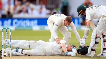 Steve Smith lies on the floor of the Lord's pitch after being hit in the head by a Jofra Archer bouncer