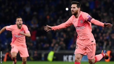 Lionel Messi celebrates scoring the opening goal for Barcelona against Espanyol in La Liga
