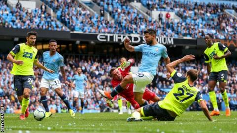 Sergio Aguero scores for Manchester City against Huddersfield