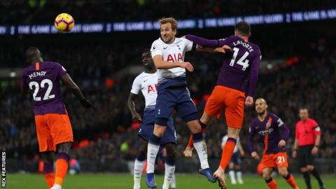Mendy, Kane and Laporte in action