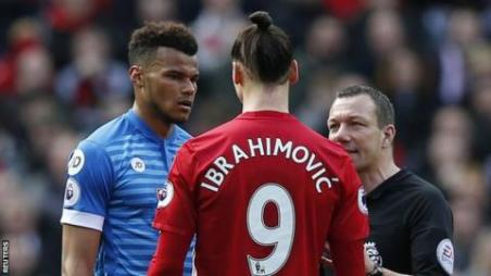 Bournemouth defender Tyrone Mings (left) and Manchester United striker Zlatan Ibrahimovic
