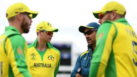 (From left to right) Australia batsmen David Warner, Steve Smith, coach Justin Langer and captain Aaron Finch talk during a warm-up session