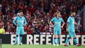 Barcelona players look dejected after conceding a goal against Granada