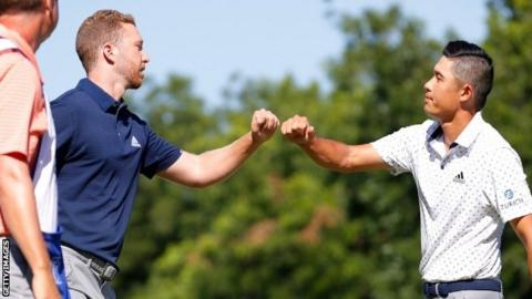 Daniel Berger (left) fist-bumps Collin Morikawa after their play-off at Colonial Country Club