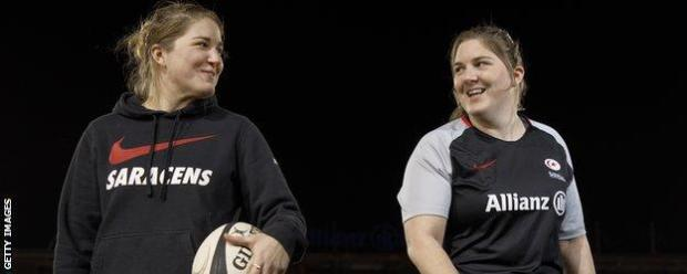 Poppy and Bryony Cleall smile at each other in Saracens kit
