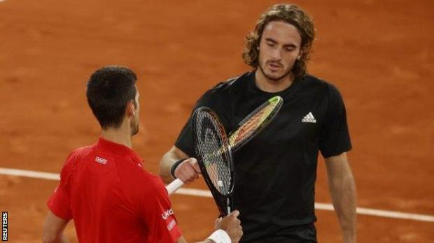 Novak Djokovic and Stefanos Tsitsipas tap racquets at the net after their thrilling French Open contest