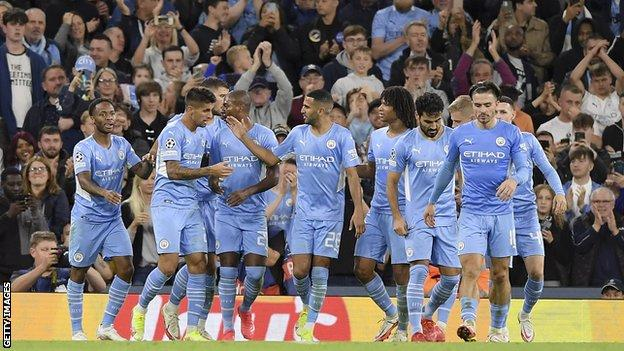 City players celebrate a goal against RB Leipzig