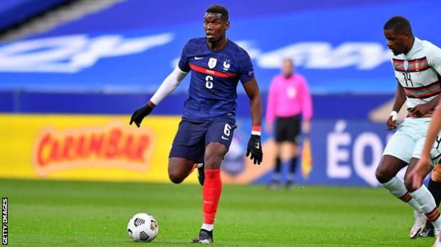 Paul Pogba playing for France against Portugal
