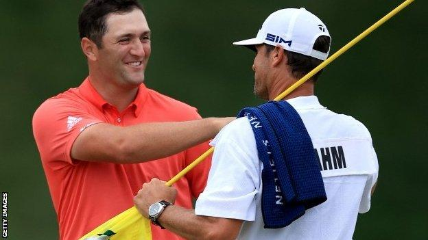 Jon Rahm celebrates his Memorial Tournament win with his caddie