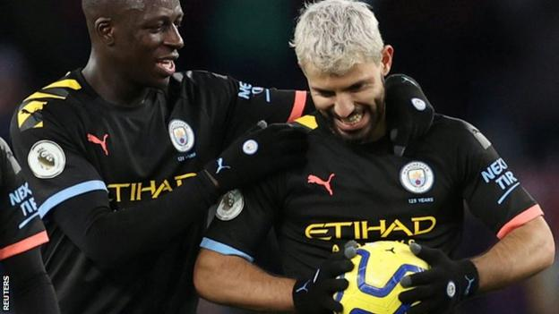 Sergio Aguero (right) clutches the match ball after scoring a hat-trick for Manchester City at Aston Villa