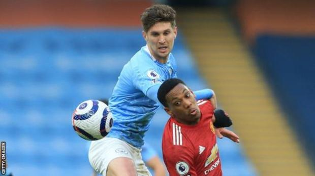Manchester City defender John Stones in action against Manchester United in the Premier League in 2020-21