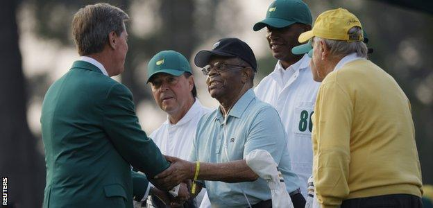 Augusta National Golf Club President Fred Ridley shakes hands with Lee Elder