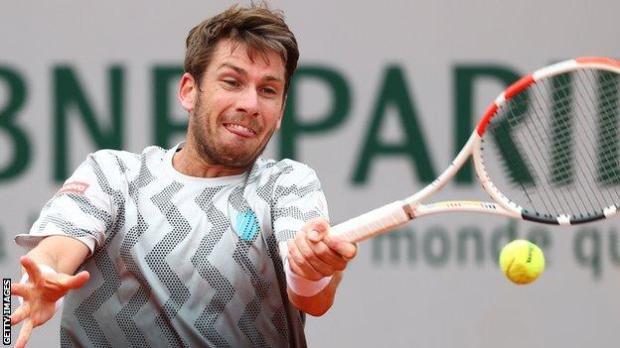 Cameron Norrie hits a return against Rafael Nadal