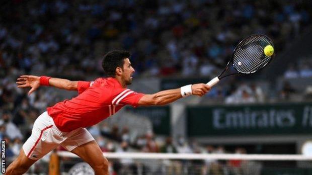 Novak Djokovic stretches for a return against Matteo Berrettini in their 2021 French Open quartar-final