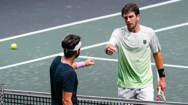 Cameron Norrie taps fists with Nikoloz Basilashvili after their match in Rotterdam