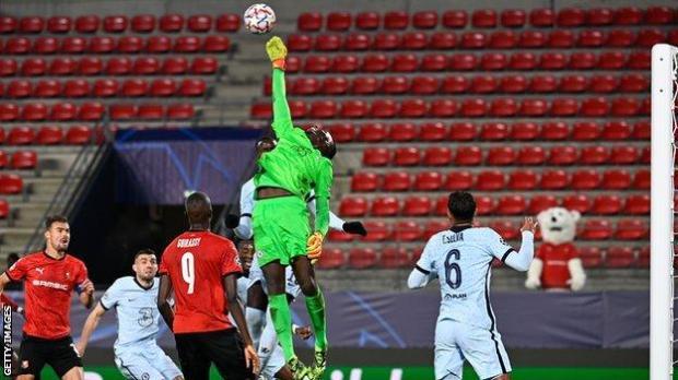 Edouard Mendy rises to palm away the ball