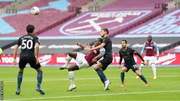 Michail Antonio scores for West Ham against Manchester City in the Premier League