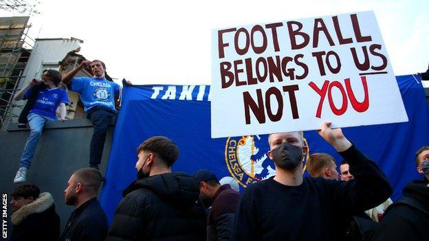 Fans protest the Super League outside Stamford Bridge