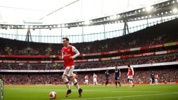 Mesut Ozil in action against West Ham on 7 March