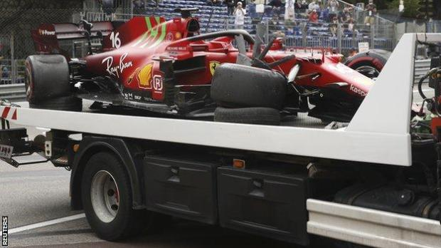 Charles Leclerc's crashed car is taken away on the back of a truck