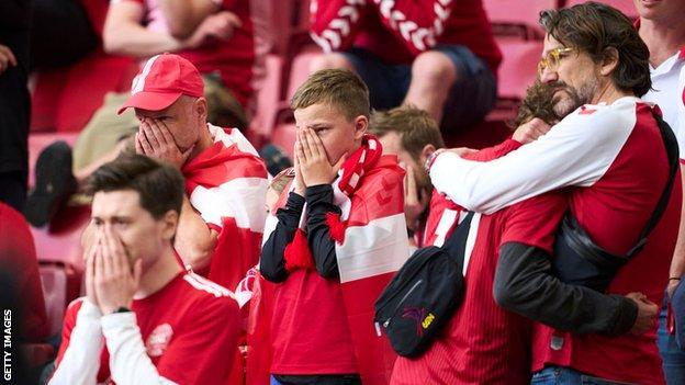 Denmark fans were visibly upset as Eriksen received treatment on the pitch