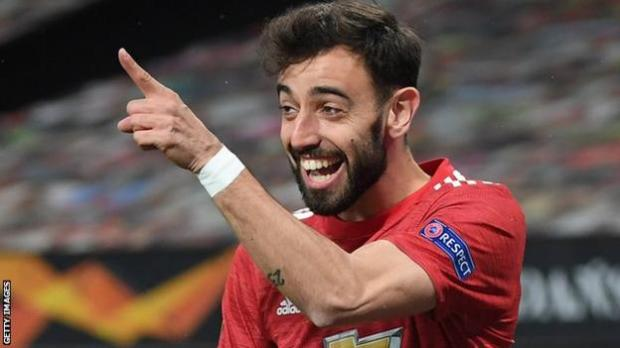 Manchester United's Bruno Fernandes celebrates scoring against Roma in the Europa League