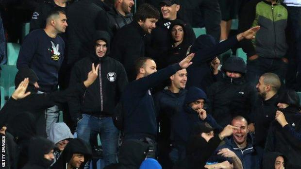 Fans at the Bulgaria v England game make what appear to be Nazi salutes