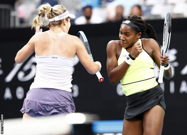 MELBOURNE, AUSTRALIA - JANUARY Catherine McNally and Coco Gauff of the United States celebrate their win in the in the Women's Doubles third round match with partner Coco Gauff against Shuko Aoyama and Ena Shibahara of Japan on day eight of the 2020 Australian Open at Melbourne Park on January 27, 2020 in Melbourne, Australia. (Photo by Darrian Traynor/Getty Images)